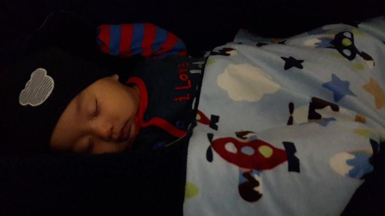 sleeping in bassinet